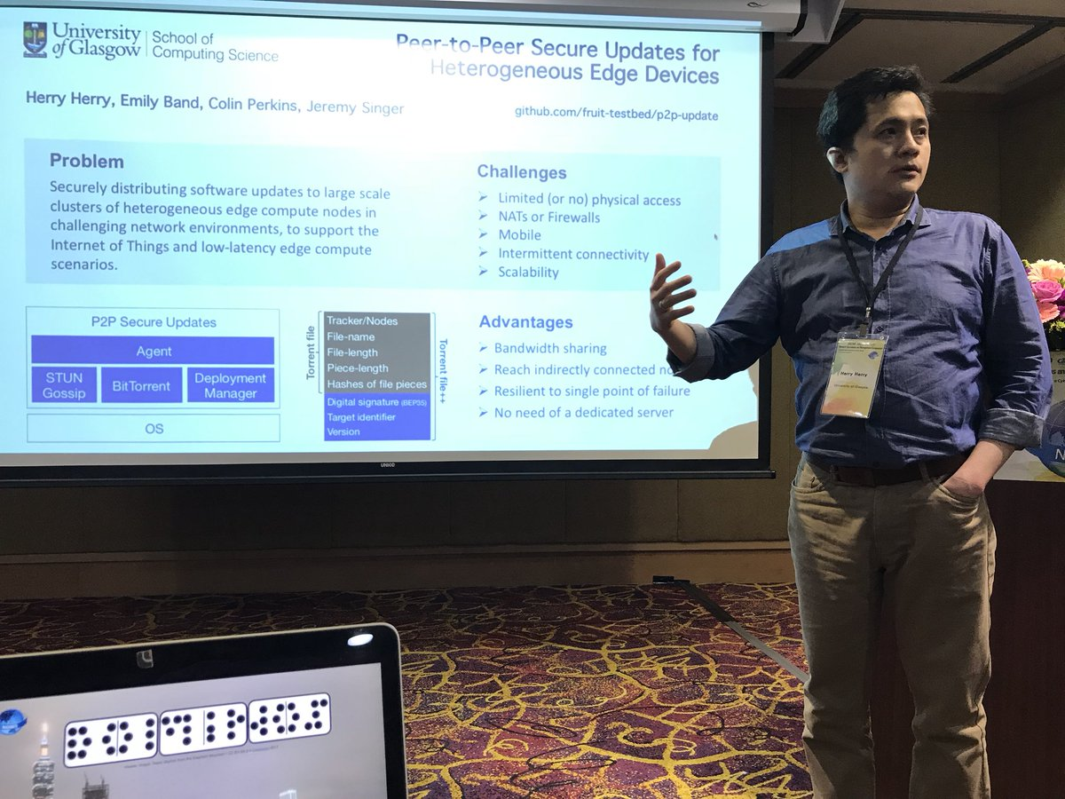 Herry presenting at the IEEE/IFIP Network Operations and Management Symposium